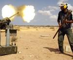 Ein Anti-Ghaddafi-Kämpfer mit schwerer Artillerie am Freitag nahe Sirte. Foto: Reuters